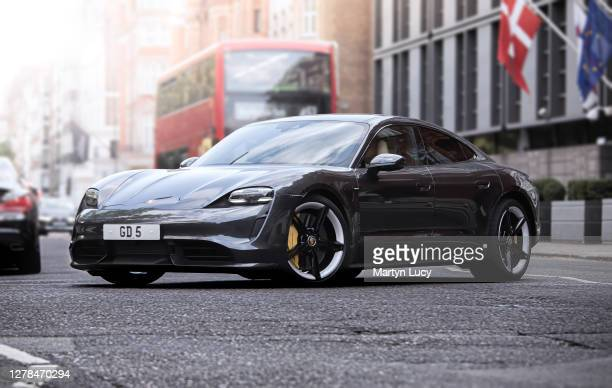 The Porsche Taycan seen in Knightsbridge, London. The Taycan is Porsches All-Electric Sports car, which is also the Marques highest selling sports...