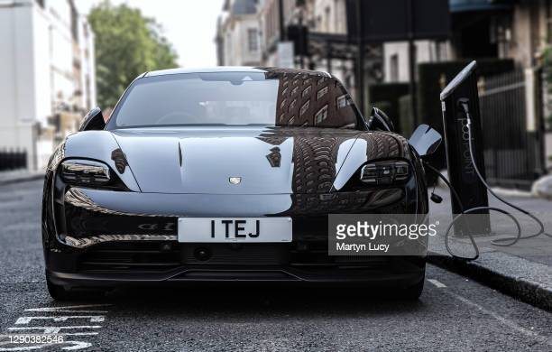 The Porsche Taycan seen in Mayfair, London. The Taycan is Porsches All-Electric Sports car, which is also the Marques highest selling sports car in...