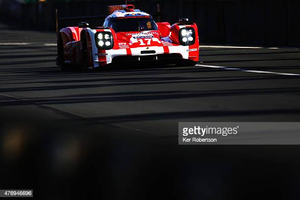 The Porsche Team 919 Hybrid of Mark Webber, Brendon Hartley and Timo Bernhard drives during morning warm up for the Le Mans 24 Hour race at the...