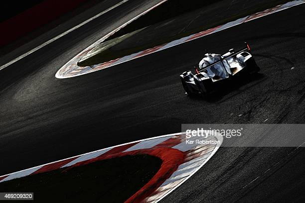 The Porsche Team 919 Hybrid of Mark Webber Timo Bernhard and Brendon Hartley drives during practice for the FIA World Endurance Championship 6 Hours...