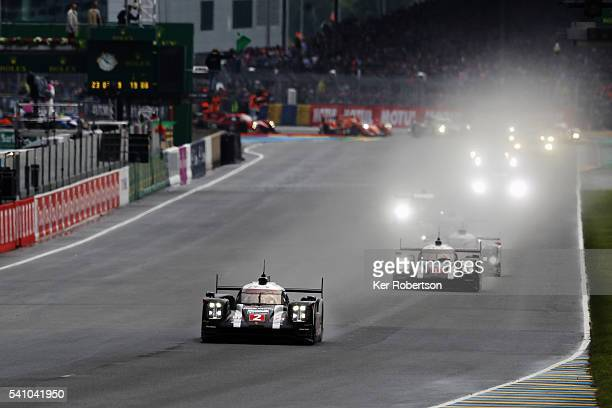 The Porsche Team 919 Hybrid of Romain Dumas Neel Jani and Marc Lieb leads the field at the start of the Le Mans 24 Hour race at the Circuit de la...