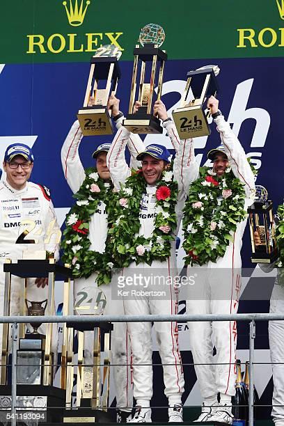 The Porsche Team 919 of Neel Jani , Romain Dumas and Marc Lieb celebrates on the podium after winning the Le Mans 24 Hour race at the Circuit de la...