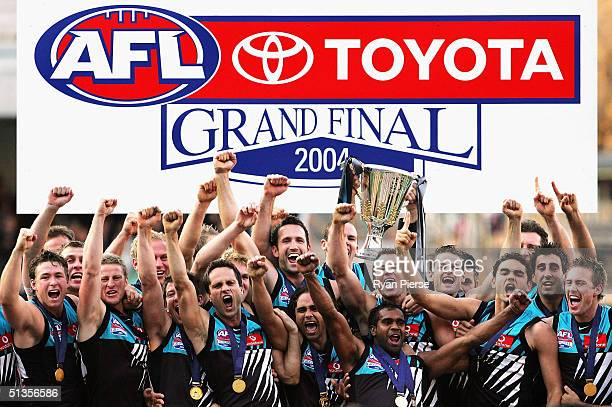 The Port Adelaide Power hold aloft the 2004 Premiership Cup after the AFL Grand Final between the Port Adelaide Power and the Brisbane Lions at the...