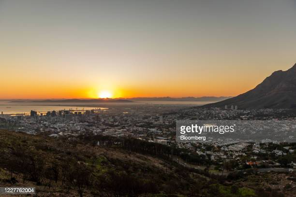 The port area and commercial highrise properties stand at the foot of Table mountain as the sun rises in Cape Town South Africa on Thursday July 23...