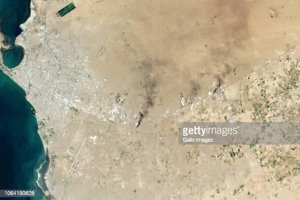 The port city of Hudaydah Yemen with visible smoke plumes