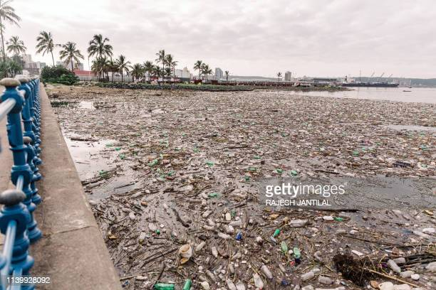 The port of Durban is swamped by tons of debris, mostly plastic and wood, on April 28, 2019. - Transnet National Ports Authority has commenced a...