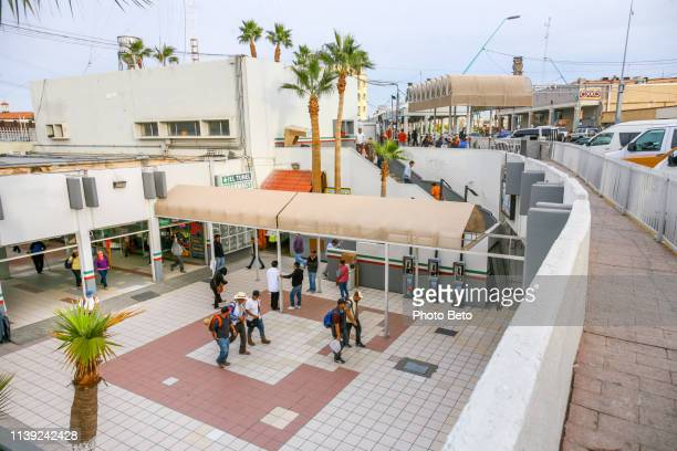 usa/mexico border - calexico - immigrants crossing sign stock photos and pictures
