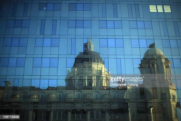The Port of Liverpool building is reflected in the glass of The new Mann Island apartment development at liverpool Water Front on March 2, 2011 in...
