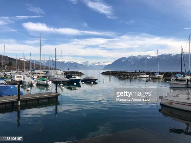 the port of lutry with sail boats and the alps in the background - lausanne stock pictures, royalty-free photos & images