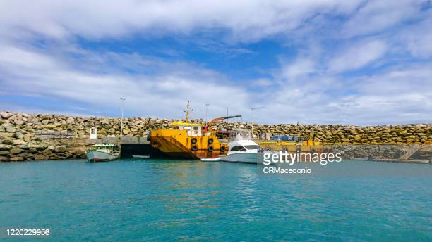 the port of santo antônio is at the northeast end of the main island of the archipelago. - crmacedonio stock pictures, royalty-free photos & images