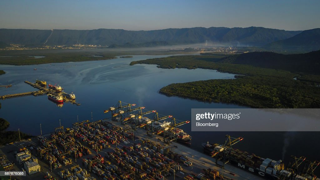 The Port of Santos is seen in this aerial photograph taken above Santos, Brazil, on Thursday, Oct. 5, 2017. The port complex is a 3-square-mile microcosm of a country buffeted by political turmoil, drug-fueled violence and persistent income inequality as it emerges from a grinding recession. Photographer: Dado Galdieri/Bloomberg via Getty Images