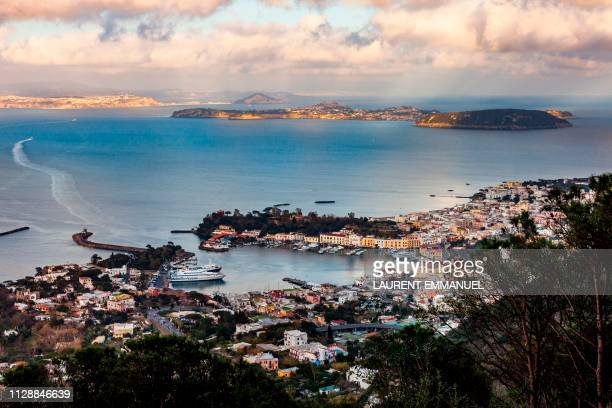 The port of the volcanic island of Ischia and the island of Procida are pictured in the Bay of Naples off Italy's western coast on the Tyrrhenian Sea...