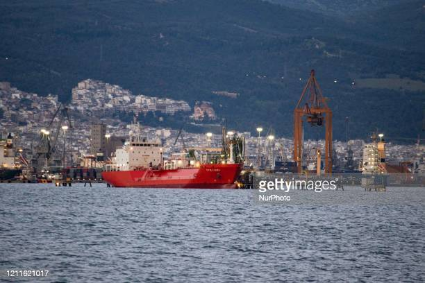 The Port of Thessaloniki in Greece as seen with vessels from Kalochori with cranes loading and unloading cargo freighter vessel ship. The harbour is...