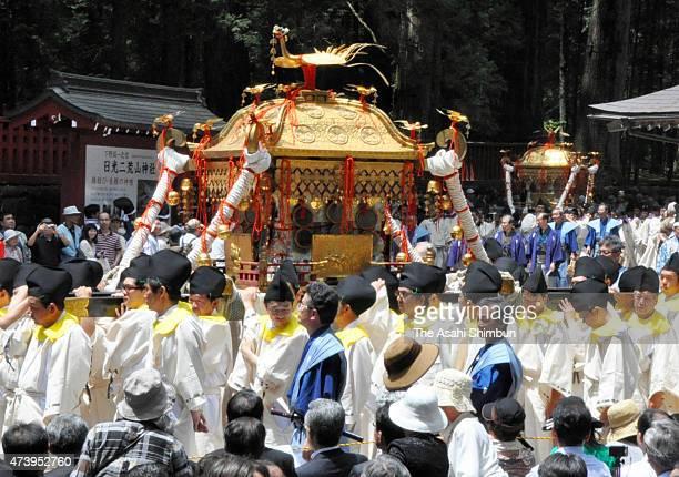 The portable shrine dedicated to Tokugawa Ieyasu is paraded down the 1kilometre approach to Nikko Toshogu shrine on May 18 2015 in Nikko Tochigi...