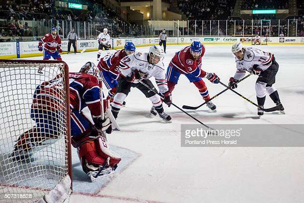 The Portland Pirates set up for a shot on goal during the second period of an AHL game vs the St John's Ice Caps at the Cross Insurance Arena...