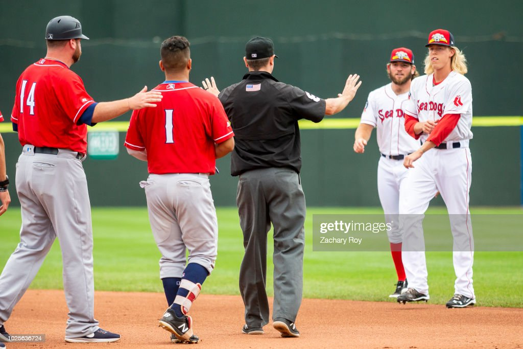 The Portland Sea Dogs bullpen storms the field after both benches clear in a game between the Portland Sea Dogs and the New Hampshire Fisher Cats at Hadlock Field on July 15, 2018 in Portland, Maine.