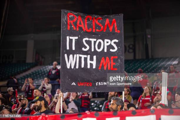The Portland Thorns supporters group, The Riveters, answer to the racial abuse sufered by goal keeper Adrianna Franch during the away match in Salt...