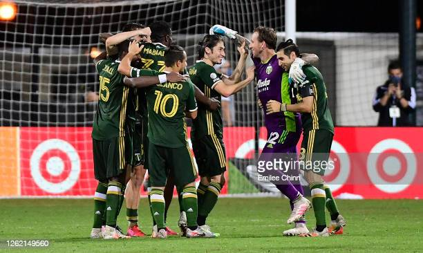 The Portland Timbers celebrate a win after penalty kicks in the round of sixteen against FC Cincinnati during the MLS Is Back Tournament at ESPN Wide...