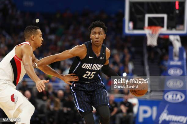 The Portland Trail Blazers' CJ McCollum left defends against the Orlando Magic's Wes Iwundu at Amway Center in Orlando Fla on Friday Dec 15 2017 The...