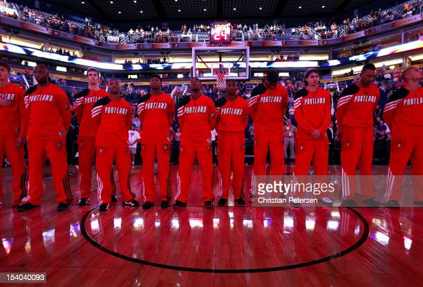 The Portland Trail Blazers line up for the National Anthem before the preseason NBA game against the Phoenix Suns at US Airways Center on October 12...