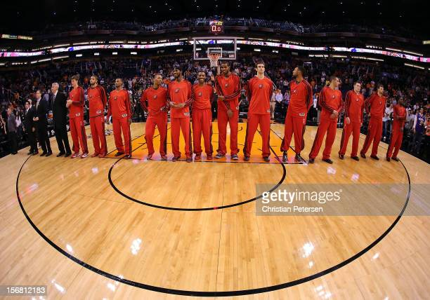 The Portland Trail Blazers line up for the National Anthem before the NBA game against the Phoenix Suns at US Airways Center on November 21 2012 in...