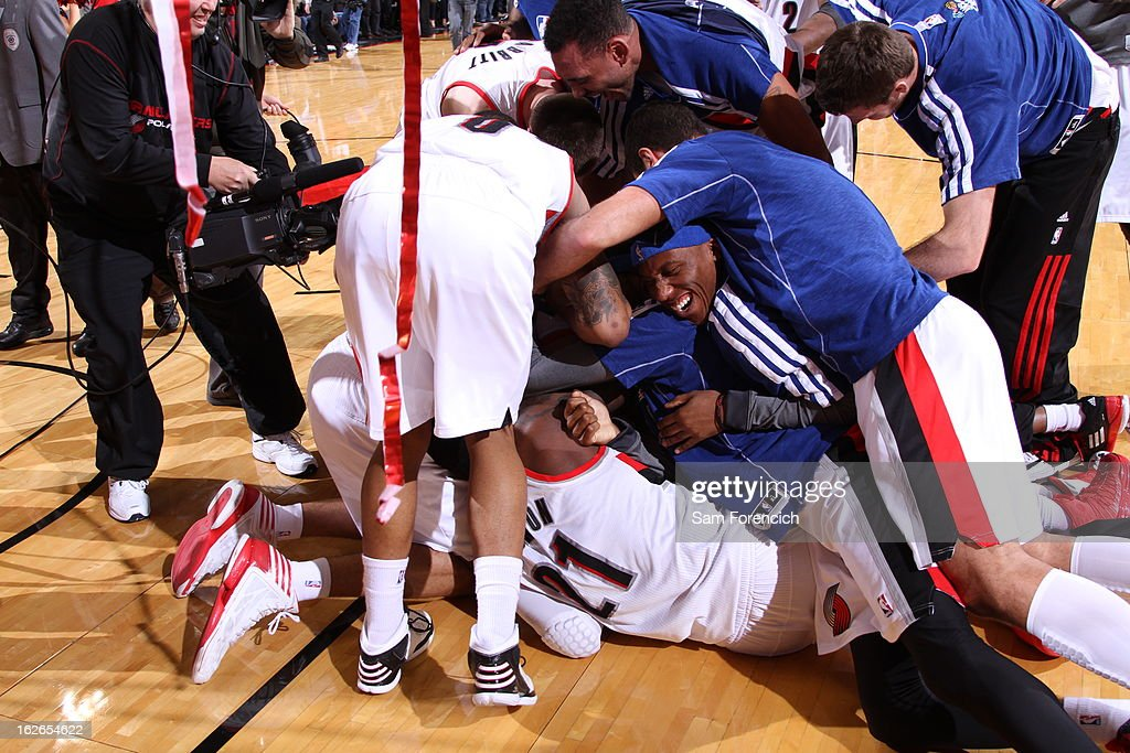The Portland Trail Blazers pile on each other after the game against the Dallas Mavericks on January 29, 2013 at the Rose Garden Arena in Portland, Oregon.