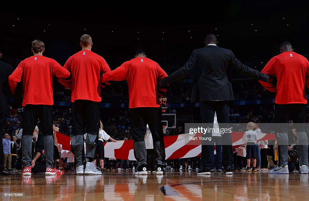 The Portland Trailblazers stand for the National Anthem before a game against the Denver Nuggets on October 29, 2016 at the Pepsi Center in Denver, Colorado.