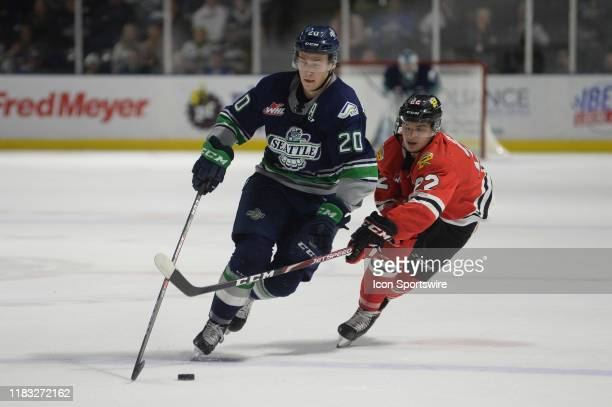 The Portland Winterhawks Jaydon Bureau tries to slow down Seattle's Conner Brugge-Cate during a WHL game between the Seattle Thunderbirds and...