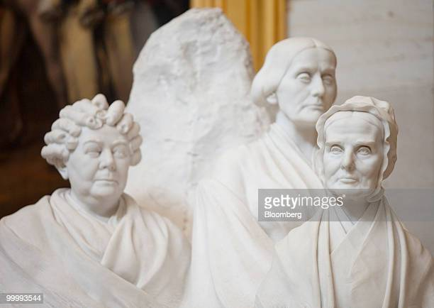 The portrait monument to Lucretia Mott Elizabeth Cady Stanton and Susan B Anthony statue sits in the Capitol building rotunda in Washington DC US on...