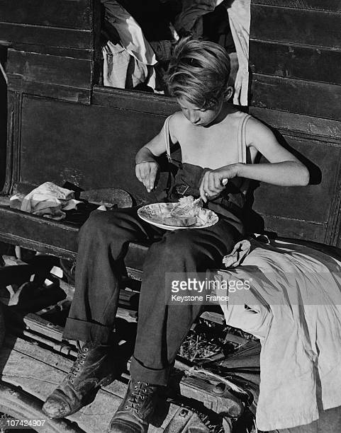 The Portrait Of A Romany Young Boy Eating In England Europe
