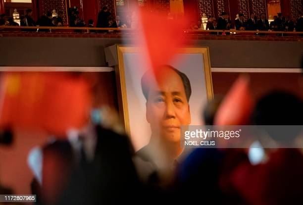 The portrait of former Chinese Communist Party leader Mao Zedong is pictured at a gala in Tiananmen Square in Beijing on October 1 to mark the 70th...