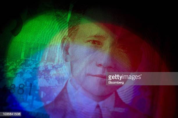 The portrait of former Philippines' President Sergio Osmena is displayed on a 50 peso banknote in an arranged photograph in Bangkok Thailand on...