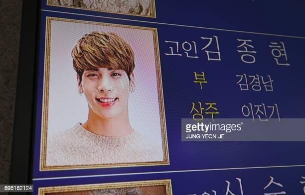 The portrait of Kim JongHyun a 27yearold lead singer of the massively popular Kpop boyband SHINee is seen on an electronic board outside a funeral...
