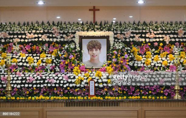 The portrait of Kim JongHyun a 27yearold lead singer of the massively popular Kpop boyband SHINee is seen on a mourning altar at a hospital in Seoul...