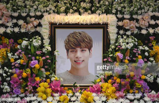TOPSHOT The portrait of Kim JongHyun a 27yearold lead singer of the massively popular Kpop boyband SHINee is seen on a mourning altar at a hospital...