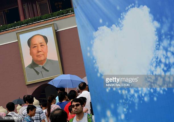 The portrait of late leader Mao Zedong hangs beside a cloud love heart during renovation work in Tiananmen Square as the city prepares for the...