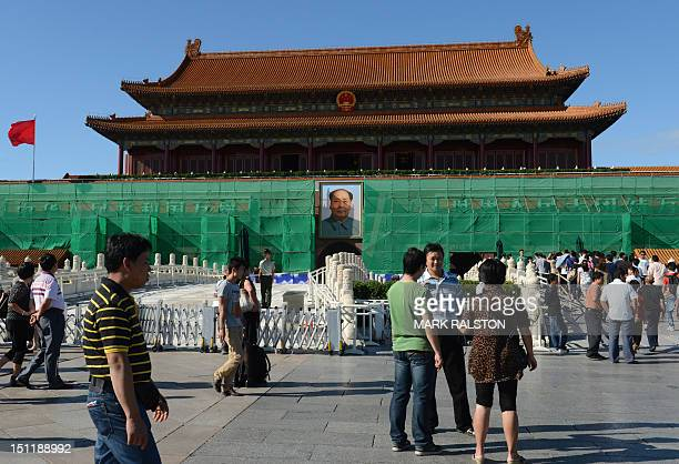 The portrait of late leader Mao Zedong in Tiananmen Square is surrounded by scaffolding as the city prepares for the upcoming 18th National Congress...