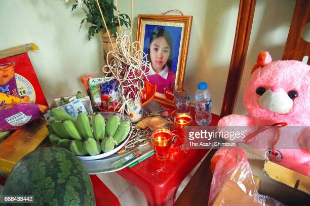 The portrait of Le Thi Nhat Linh, who was murdered last month, is seen after the arrest of the suspect on April 14, 2017 in Haiphong, Vietnam. Le...