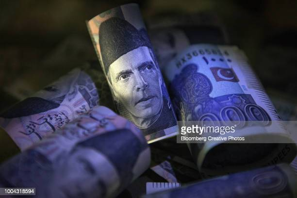 the portrait of mohammad ali jinnah, pakistan's founder, is seen on a pakistani one thousand rupee banknote - pakistan currency stock photos and pictures
