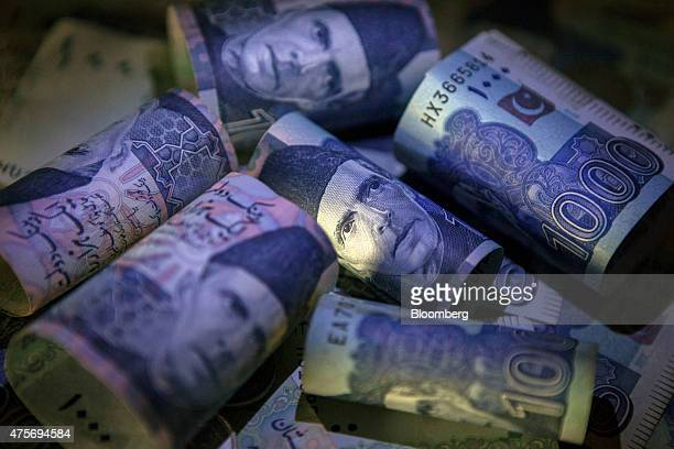 The portrait of Mohammad Ali Jinnah Pakistan's founder is seen on Pakistani one thousand rupee banknotes in an arranged photograph in Karachi...