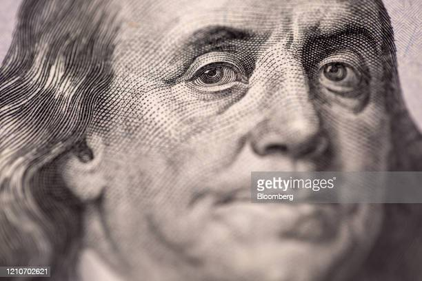 The portrait of US founding father Benjamin Franklin is displayed on a US onehundred dollar banknote in an arranged photograph taken in Hong Kong...