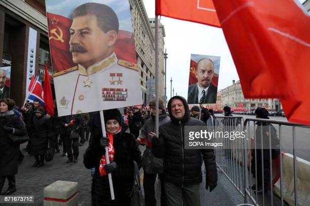 The portrait of Vladimir Lenin and Joseph Stalin seen during the march. Thousands marched to Revolution Square in central Moscow to commemorate the...