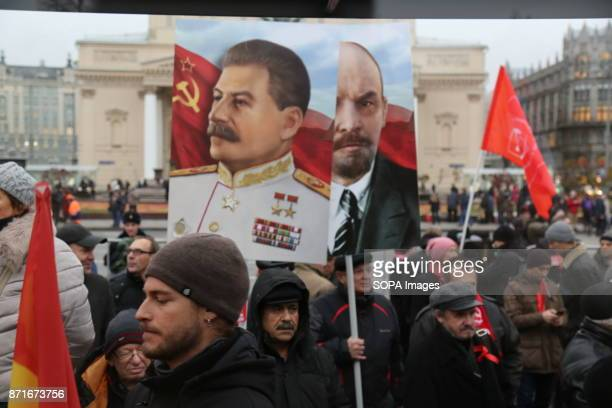 The portrait of Vladimir Lenin and Joseph Stalin seen during the march Thousands marched to Revolution Square in central Moscow to commemorate the...