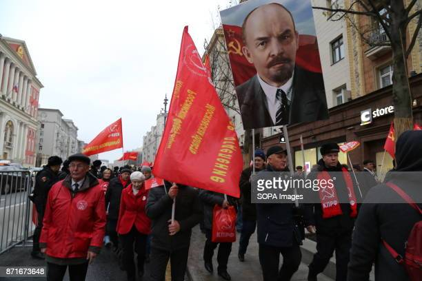 The portrait of Vladimir Lenin seen displayed during the march Thousands marched to Revolution Square in central Moscow to commemorate the 100th...