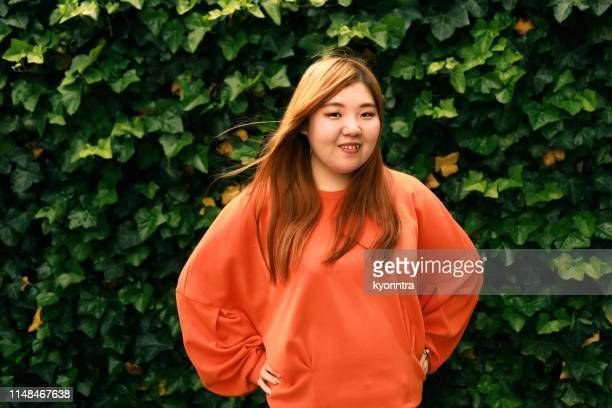 the portrait video of asian woman - chubby asian woman stock pictures, royalty-free photos & images