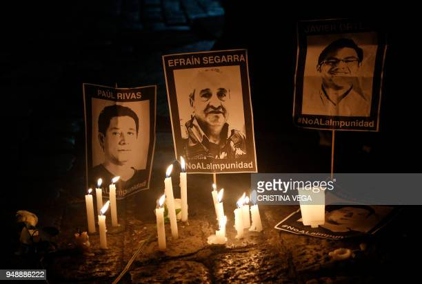 The portraits of Ecuadoran journalist team members kidnapped and executed by Renegade Colombian rebels are displayed during a march organized by...