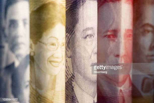 The portraits of former Philippines' Acting President José Abad Santos from left and former Philippines' Presidents Corazon Aquino Manuel A Roxas...