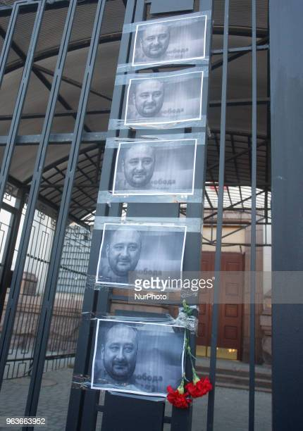 The portraits of killed Russian journalist Arkady Babchenko are seen on a fence of Russian embassy in Kyiv Ukraine 30 May 2018 Russian journalist...