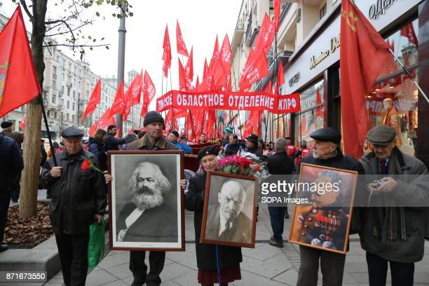The portraits of the soviet heros being carried by the participants of the march Thousands marched to Revolution Square in central Moscow to...