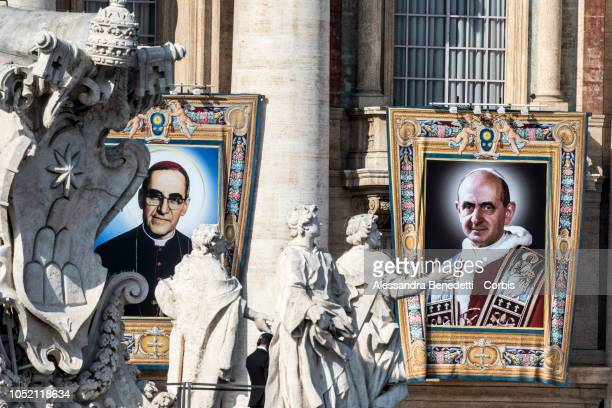 The Portraits Pope Paul VI and the martyred Salvadoran Archbishop Oscar Romero are seen during the canonisation presided by Pope Francis of seven new...